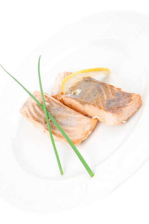 pink salmon: sea food : roasted pink salmon fillet with chinese onion, and lemon on white dish isolated over white background