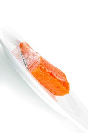 redfish: smoked salmon chunk on a big white plate