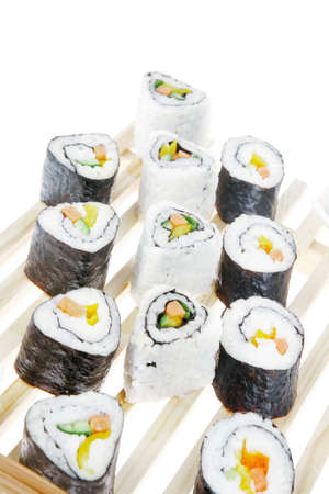 soysauce: Roll with Cucumber , Cream Cheese with raw Tuna and Salmon inside. on wooden grid . Isolated over white background . Japanese traditional Cuisine