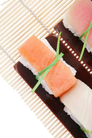 maguro: Japanese Cuisine - Different Types of Nigiri Sushi : Tuna (maguro) Salmon (sake) and Eel (unagi) with Wasabi and Ginger on bamboo mat isolated over white background Stock Photo