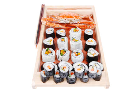 soysauce: Maki Rolls and California rolls made of fresh raw Salmon, Tuna and Eel with Cream Cheese and Avocado . Isolated over white background . on wooden plate with live crab . Maki Sushi and Nigiri