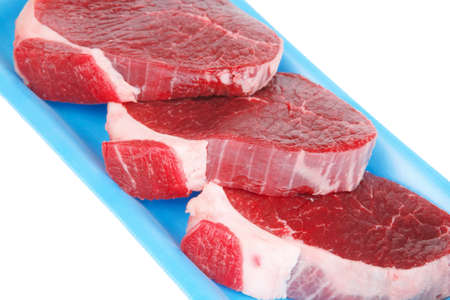 circular muscle: fresh meat : raw uncooked fat lamb pork fillet mignon loin on blue tray isolated over white background