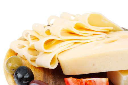 edam: yellow edam cheese sliced on wooden platter with olives and tomato isolated over white background Stock Photo