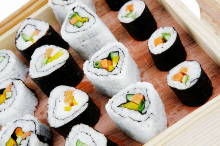 soysauce: Japanese Cuisine - Maki Roll with Deep Fried Vegetables inside . on wooden plate . isolated over white background Stock Photo
