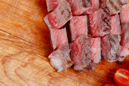 meat food: meat food : roast beef steak on wood plate isolate on white background