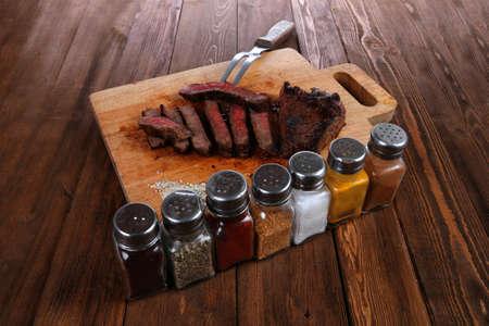 pepperbox: grilled beef fillet steak on fork over wooden board
