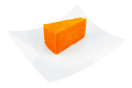 cheez: french gourmet dark cheddar cheese served on a ceramic plate isolated over white background Stock Photo