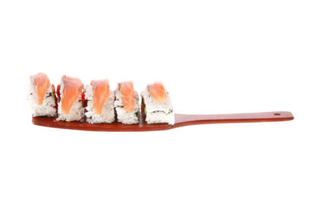 inside out: sushi onigiri inside out californian rolls on wooden paddle isolated on white background