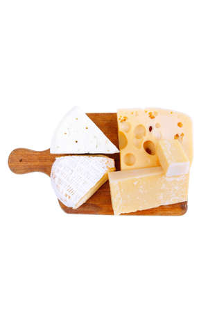 edam: solid french cheese parmesan brie and edam on wooden platter isolated on white background