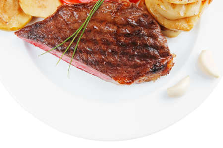 meat food: meat food : roasted fillet on white plate with tomatoes and chives isolated over white background Stock Photo
