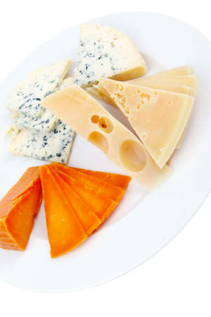 gruyere: fresh aged french cheese parmesan roquefort and gruyere chops with slices on plate with isolated over white background