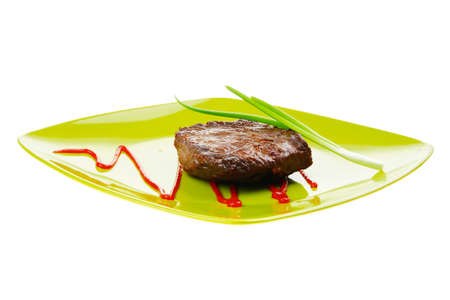 meat food: meat food : roast beef fillet mignon served on green plate with chives and ketchup isolated over white background