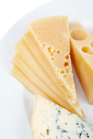 stilton: old blue stilton roquefort with orange cheddar and yellow parmesan and slices on plate with isolated over white background