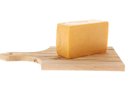 cheez: aged italian deli fresh cheddar cheese served on wooden cutting plate isolated over white background