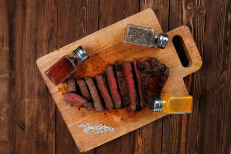 pepperbox: fresh roast red beef meat fillet mignon cutted on wooden plate