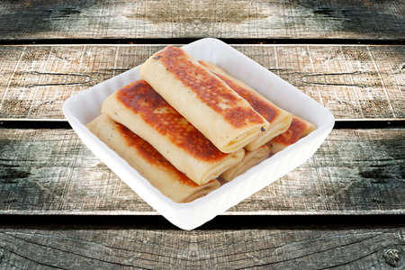 russian food: russian food - pancake with various fillings served over old style wooden table