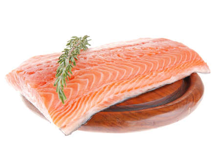 fish plate: fresh raw red fish fillet on wooden plate and rosemary Stock Photo
