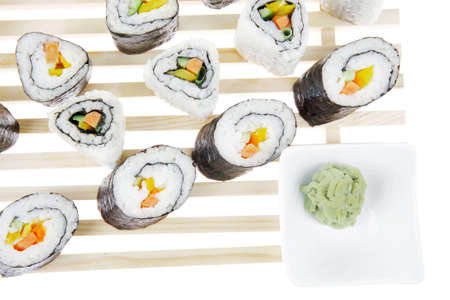 soysauce: Maki Rolls and California rolls made of fresh raw Salmon, Tuna and Eel with Cream Cheese and Avocado . Isolated over white background . on wooden grid . Maki Sushi and Nigiri