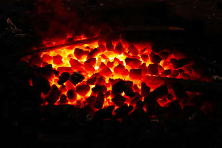 fireside: image of stone charcoal fire on bugle as abstract background