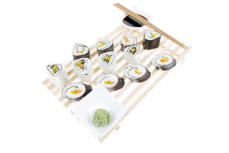 soysauce: Maki Roll with Deep Fried Vegetables inside . on wooden grid . isolated over white background . Japanese Cuisine Stock Photo