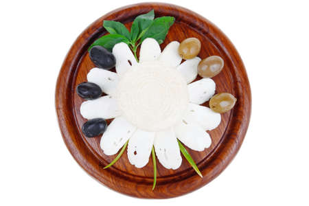 full of holes: dairy products : feta white cheese sliced on cut board with olives and basil leaves isolated over white background