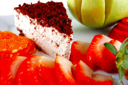 chocolaty: cream cake, raw apple, and strawberry on plate
