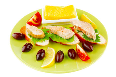king salmon: salmon on baguette slices with butter and dark olives