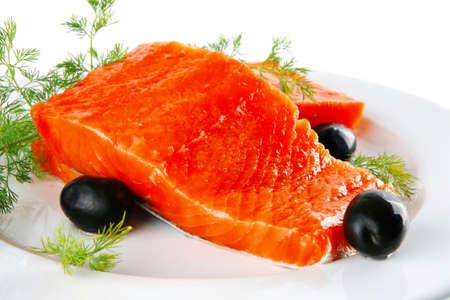 redfish: sinlge pink salmon bit on a big white dish