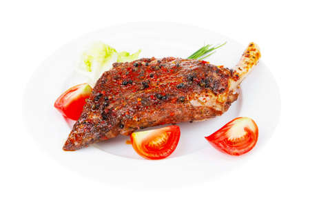 savory: savory on white plate: grilled meat shoulder with tomato and chives isolated on white background