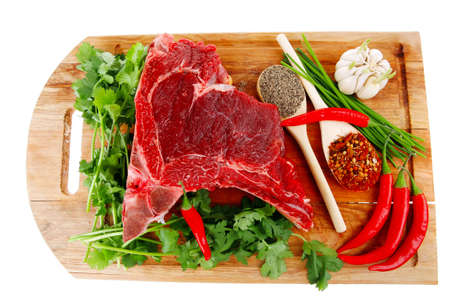 green stuff: butchery : fresh raw beef lamb big rib ready to cooking with green stuff on wooden plate isolated over white background