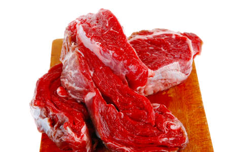 castor: raw steak ready to prepare on cut board with cutlery and castor Stock Photo
