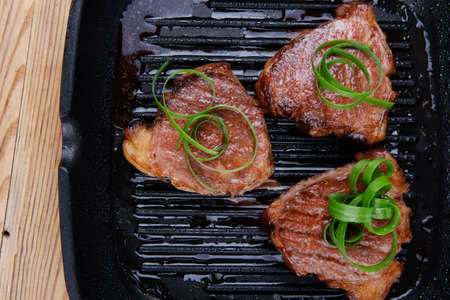 teflon: grilled beef fillet strips on grill teflon black plate over wood