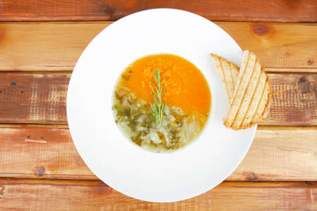 european cuisine: european cuisine: dual components vegetable soup with toasts over wood