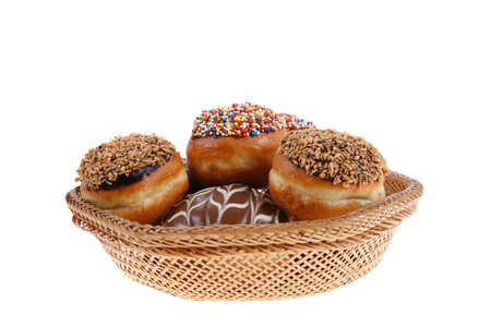 cake factory: traditional jewish holiday chanuka donuts covered by dark chocolate on retro vintage basket isolated on white background