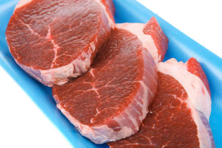 circular muscle: raw meat : fresh beef pork big tenderloin strip on blue tray isolated over white background