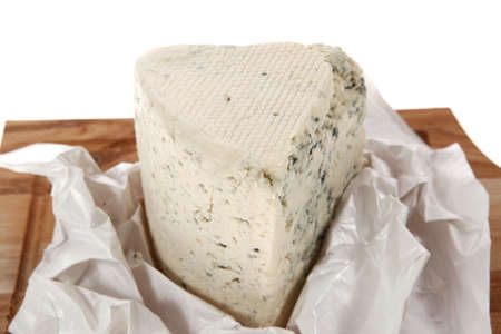 stilton: aged italian deli fresh blue stilton cheese served on wooden cutting plate isolated over white background