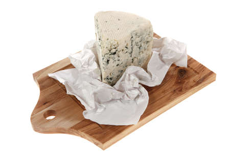 cheez: aged italian deli fresh blue stilton cheese served on wooden cutting plate isolated over white background