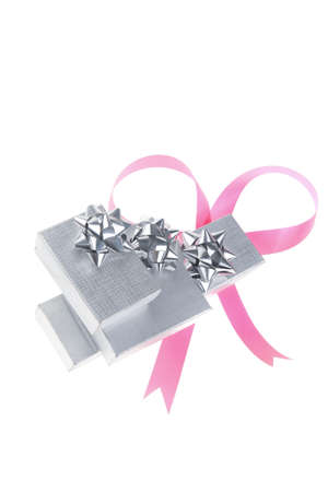 silver gift box with pink bow isolated over white background Stock Photo