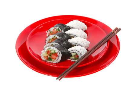 californian: fresh japan maki and onigiri sushi on red plate with sticks isolated on white background