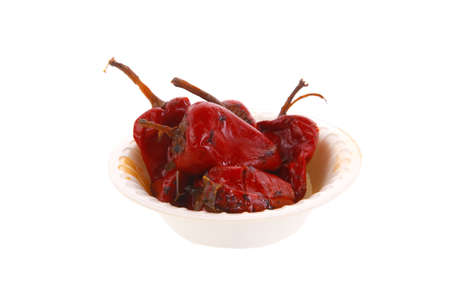 ove: red hot small chili pepper in side bowl isolated ove white background Stock Photo