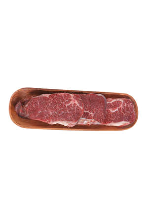 porterhouse: three fresh raw marble beef meat sirloin porterhouse steak on long wooden tray isolated on white background Stock Photo