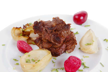 beef bourguignon in wine with artichoke and marinated vegetables on white plate isolated over white background Stock Photo