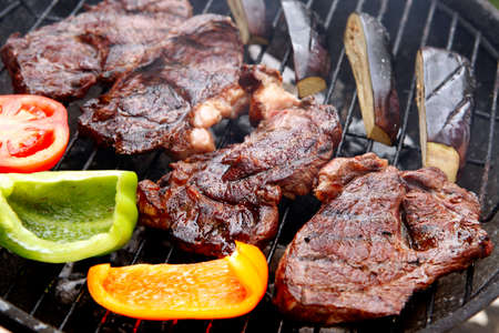 ready grilled fillet mignon served with garnish of eggplants on barbecue bbq grill