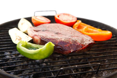 fresh raw big fillet chunk served on bbq grill with pepper bell tomatoes and eggplant ready to prepare Stock Photo