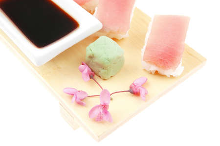 soysauce: Japanese traditional Cuisine - Set of Nigiri sushi topped with raw Tuna (maguro) . Isolated over white background
