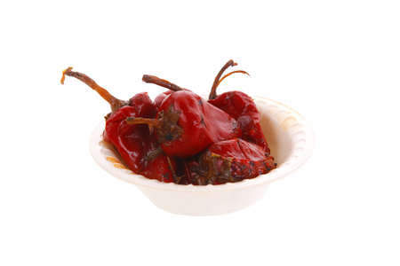 red hot small chili pepper in side bowl isolated ove white background Stock Photo
