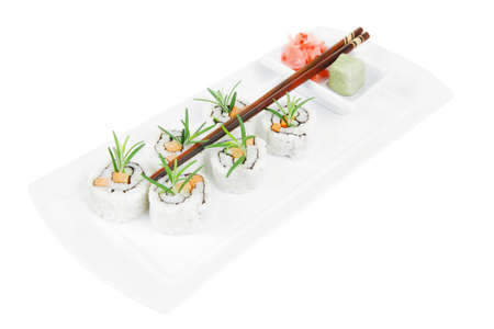 soysauce: Japanese Cuisine - California Roll made of Fresh raw Salmon, Cream Cheese and Avocado inside. Served with wasabi and ginger . on long white plate isolated over white background