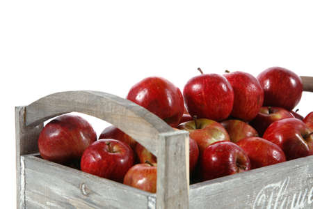 flavorful: fresh red apples in vintage grey box ready to sell isolated on white background
