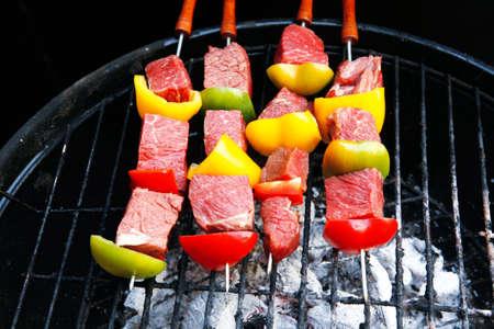 fresh raw beef shish kebab with pepper chunk on black big grill bbq Stock Photo