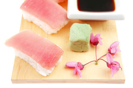 soysauce: Japanese Cuisine - Set of Nigiri sushi topped with raw Tuna (maguro) . on wooden board . isolated over white background